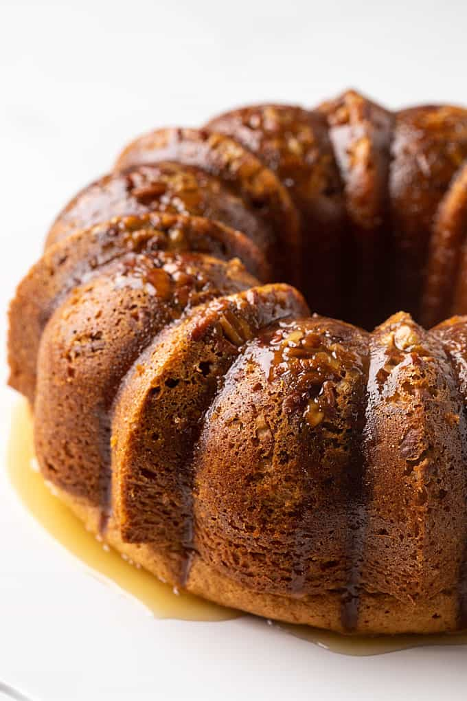 Bacardi rum bundt cake on a white cake stand