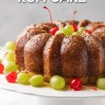 Front view of a rum bundt cake on a cake stand with overlay text.