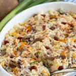 """Potato casserole in a white baking dish. Text at top reads, """"Loaded Baked Potato Casserole""""."""