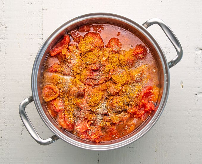 Overhead view of stew in a stainless pot before cooking.