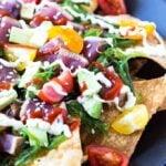 Tuna Nachos - Fried wontons topped with seaweed salad, seared tuna, tomatoes, avocado, sesame seeds and drizzled with wasabi mayo and sriracha.