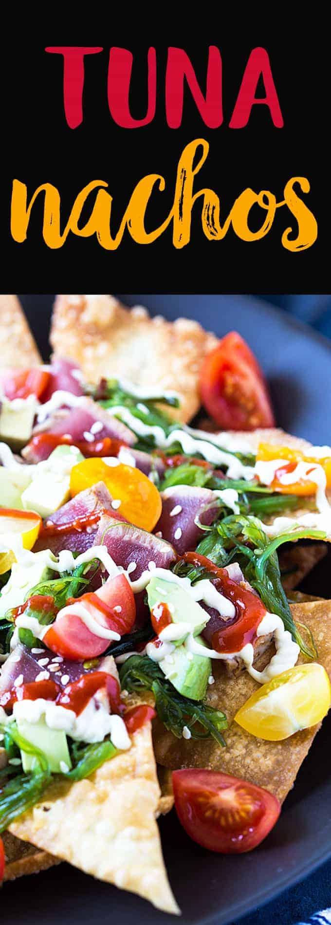 A closeup view of sliced seared tuna and seaweed salad over fried wontons.