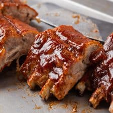 Oven baked barbecue pork ribs on a baking sheet