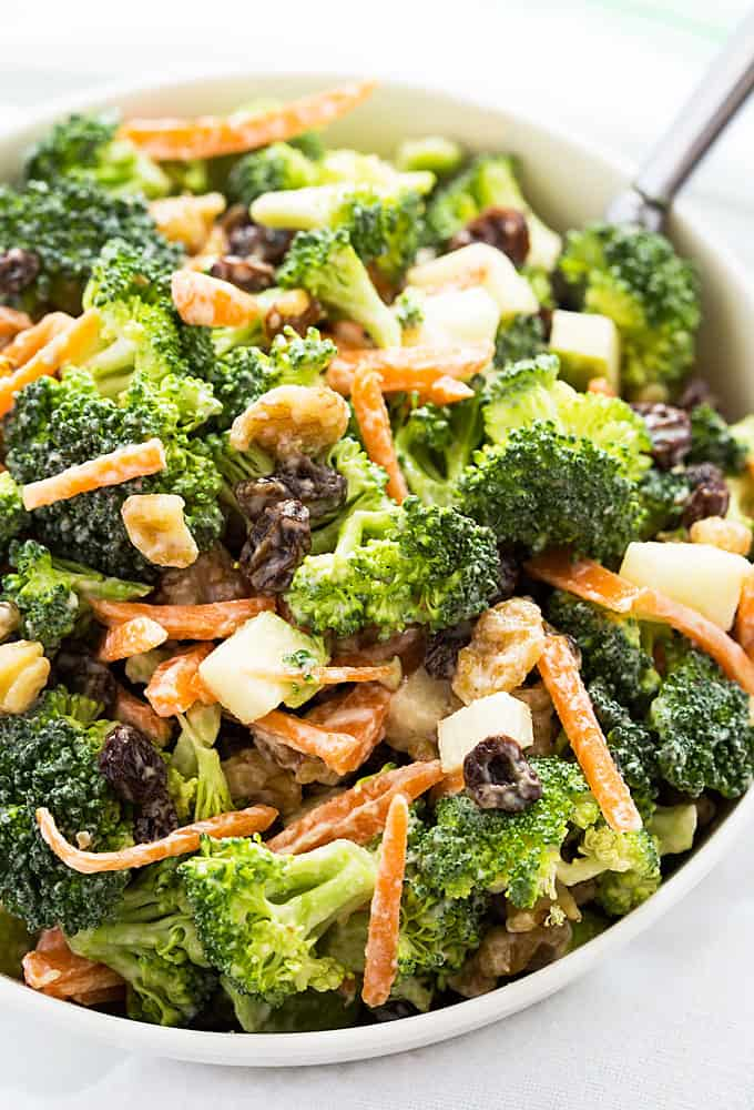 Creamy Broccoli Salad - Broccoli, chopped apples, walnuts, carrots and raisins in a sweet and tangy dressing.