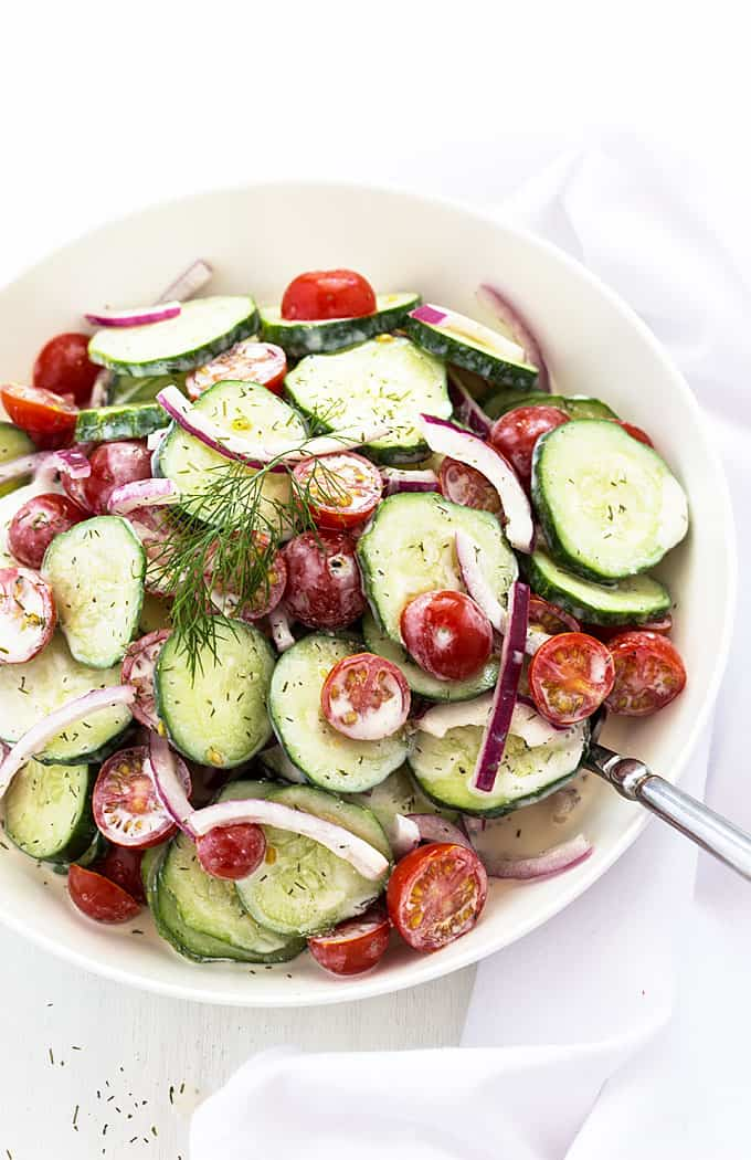 Creamy Cucumber Salad - Cucumbers, tomatoes and red onions in a dill and sour cream dressing.