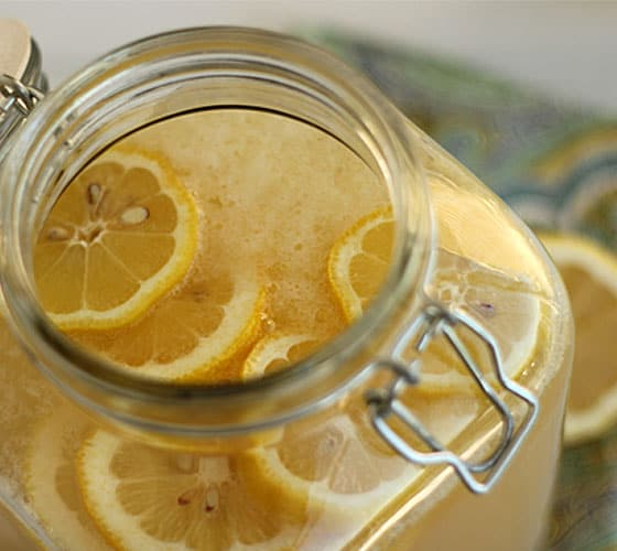 Overhead view of lemonade cocktail in a large glass beverage jar.