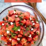 Watermelon salad in a glass bowl with overlay text at top.