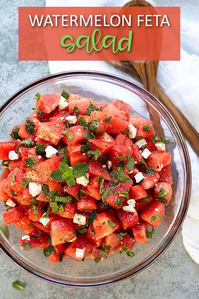 "Watermelon Feta Salad in a glass bowl. Text at top reads, ""Watermelon Feta Salad"""