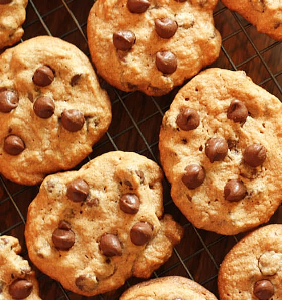 Overhead closeup view of chocolate chip cookies on a wire baking rack.