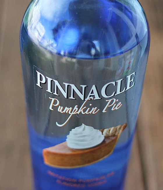 A blue bottle of vodka with a picture of a slice of pumpkin pie on the label.