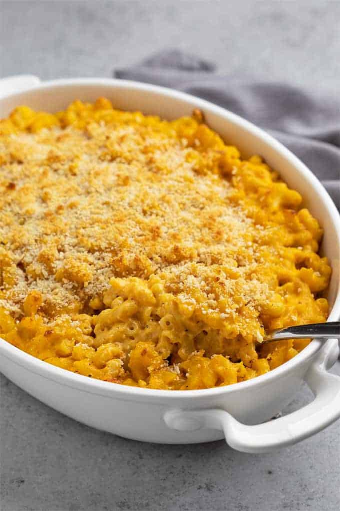 Baked pumpkin mac and cheese in an oval white baking dish