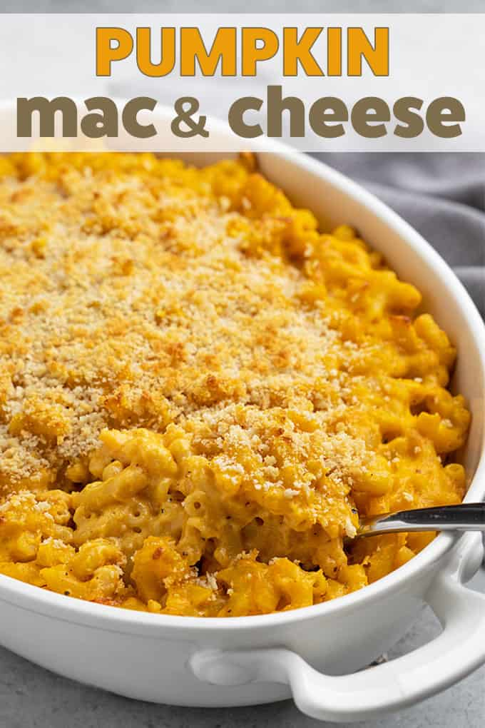 Macaroni and cheese in a white baking dish with a spoon.  Text at top of image.