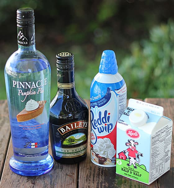 Bottles of vodka, Irish creme liqueur, a can of whipped topping and carton of half and half.