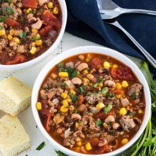 Black-Eyed Pea and Sausage Stew - An easy stew with black-eyed peas, stewed tomatoes, corn and hot sausage... on the table in 30 minutes!