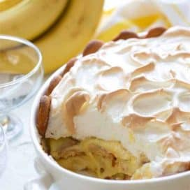 Easy banana pudding topped with meringue in a white oval baking dish