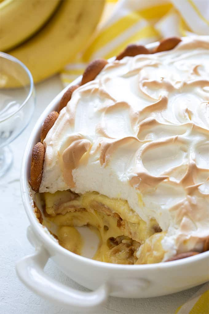 Easy Southern banana pudding topped with meringue with a serving removed from the dish
