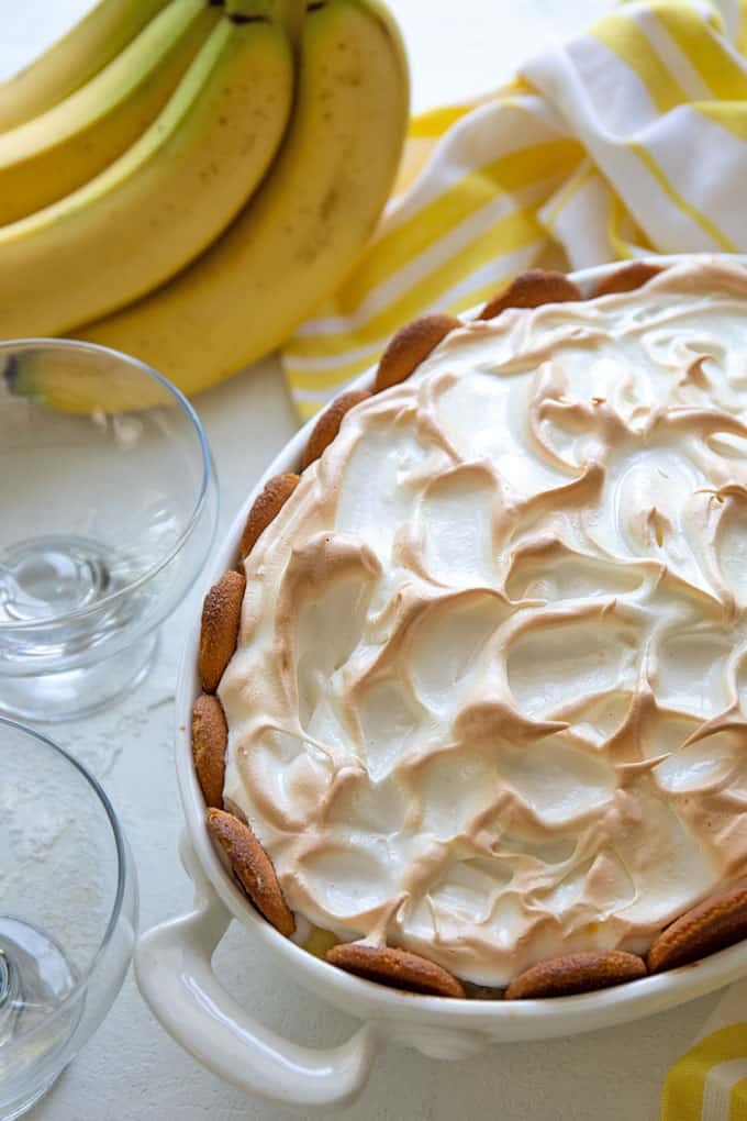 Overhead view of banana pudding topped with meringue in a white baking dish