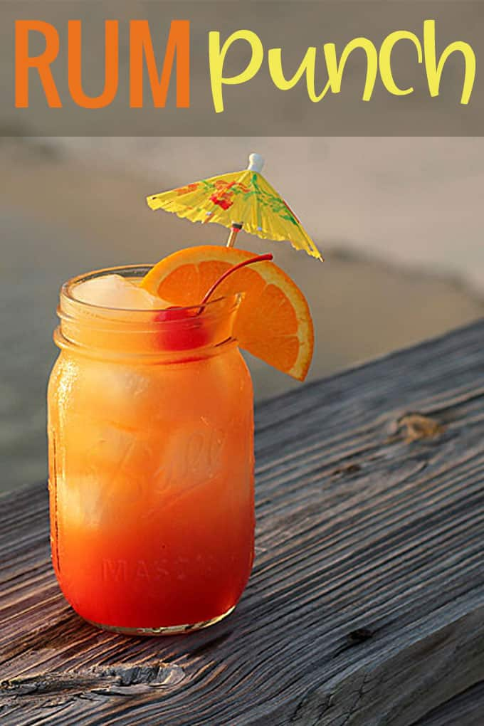 A fruity rum cocktail in a mason jar on a wood surface.  Text at top of image.