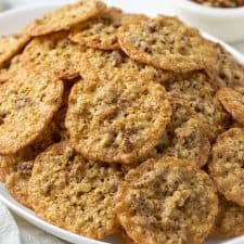 Oatmeal Lace Cookies on a white oval serving platter