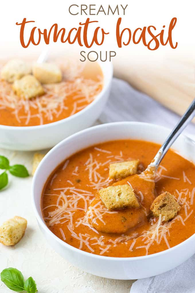 A closeup of a spoonful of tomato soup in a white bowl. Overlay text at top of image.