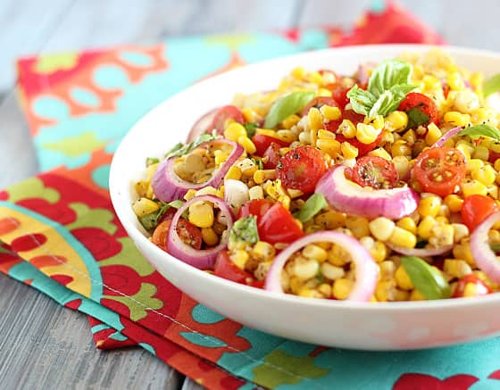Front view of Corn and Tomato Salad with red onion and basil in a bowl