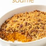 Souffle in an oval white baking dish. Overlay text at top of image.