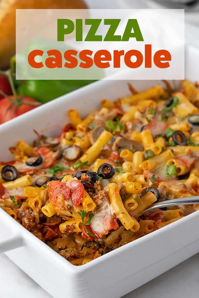 A casserole in a white rectangle baking dish with a spoon.