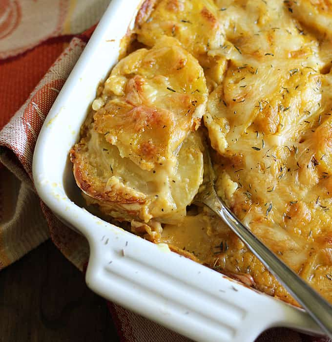 Swiss cheesy and creamy Pumpkin Scalloped Potatoes seasoned with chipotle pepper and thyme
