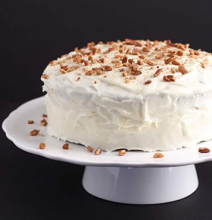 Carrot Cake with Cream Cheese Frosting ~ Perfectly moist and chock full of carrots, pecans and raisins!