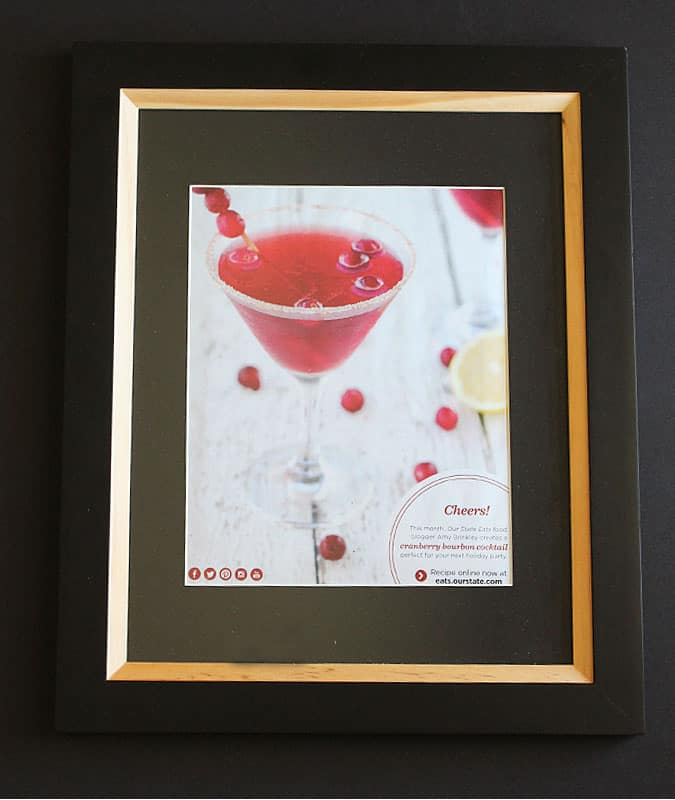 A page of a magazine featuring a martini framed in a black and tan picture frame.