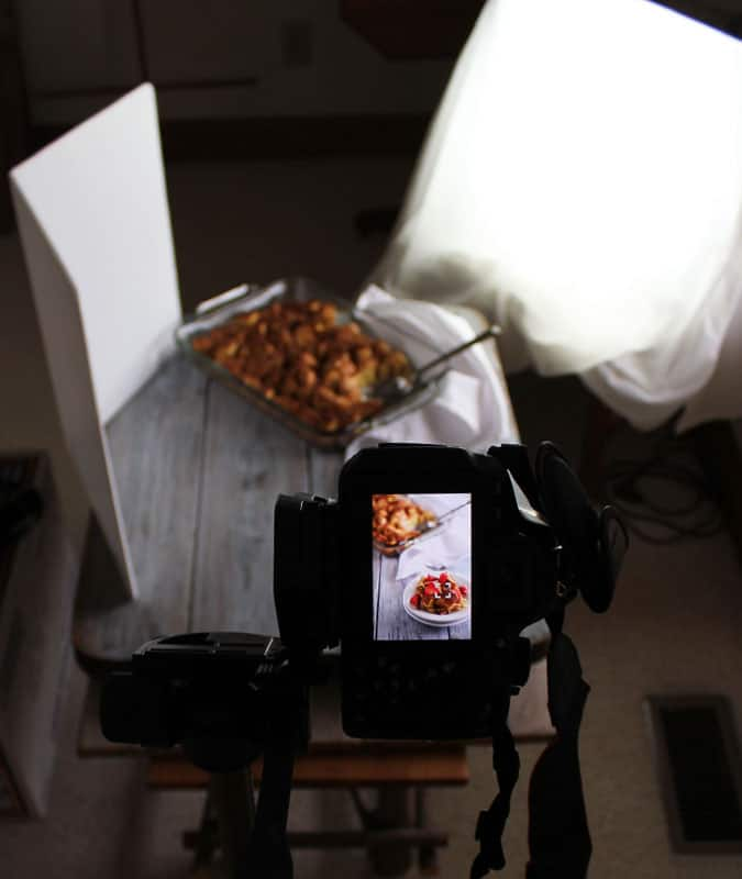 View of behind a camera photographing a casserole.