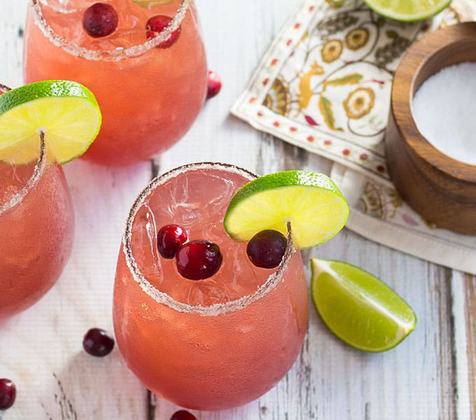 Cranberry Margaritas -- These festive, delicious and EASY margaritas come together with just a few simple ingredients!