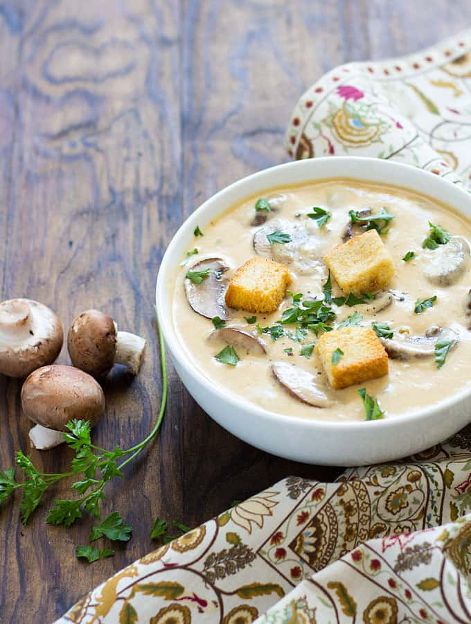 Creamy Mushroom Cheddar Soup - This comforting soup is chock full of mushrooms and ohhhh so cheesy and creamy!