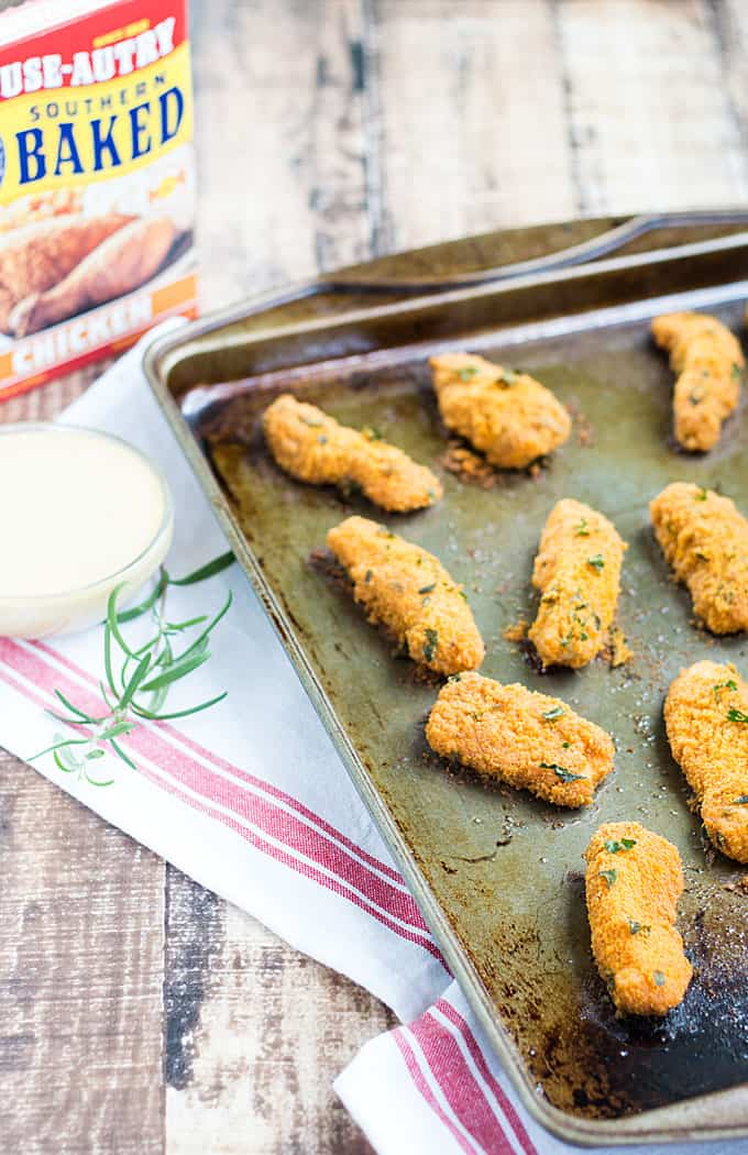 Herb Breaded Chicken Fingers with Honey Mustard Sauce – oven baked, crispy on the outside and tender on the inside chicken fingers with a sweet & tangy dipping sauce!