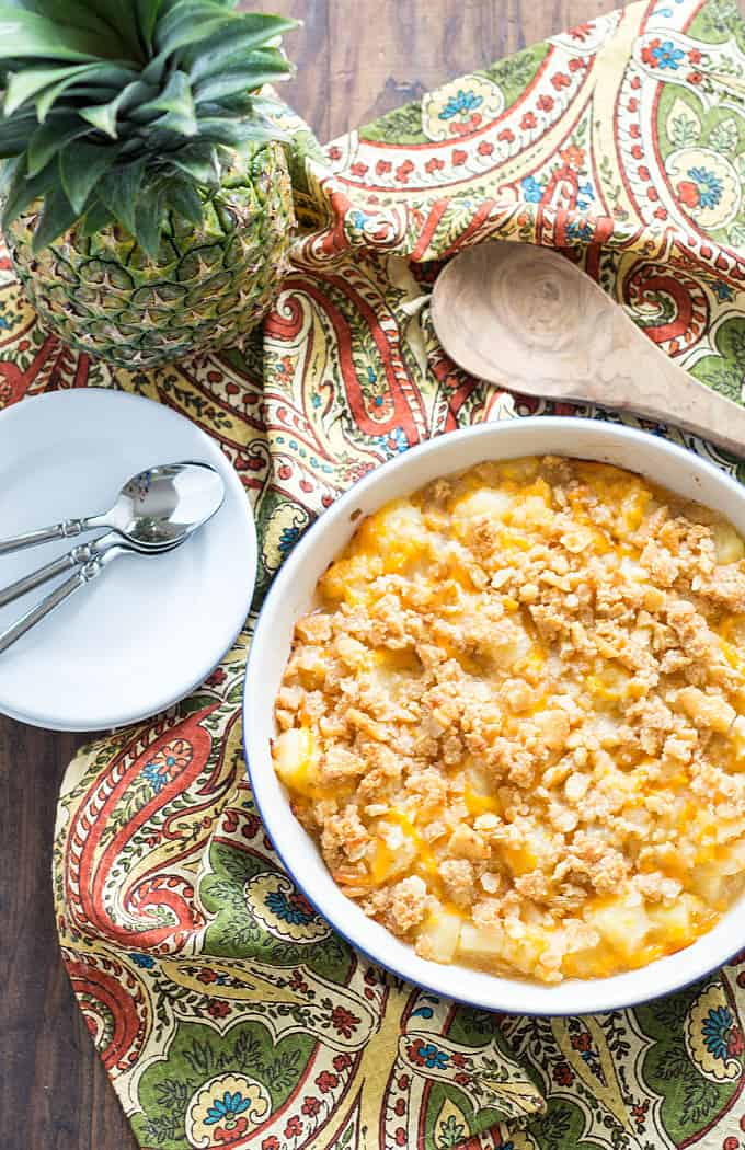 Pineapple Casserole - Cheesy pineapple casserole with a hint of cinnamon and a buttery, crunchy topping.