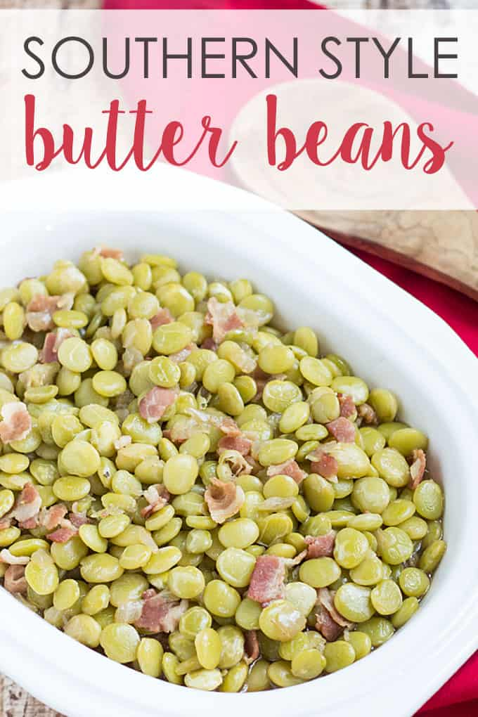 Southern Style Butter Beans in a white bowl  with a wooden spoon and a red napkin.