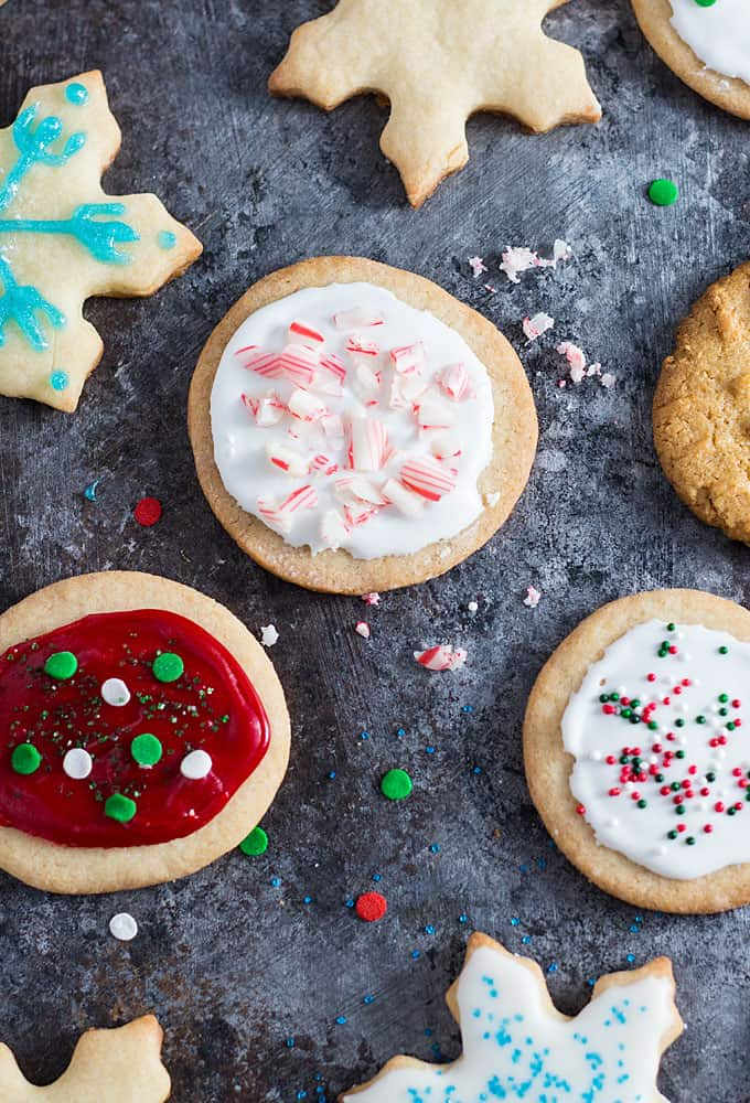 Overhead closeup view of assorted holiday cookies on a dark surface.