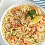 Shrimp and linguine pasta in a white bowl with overlay text.