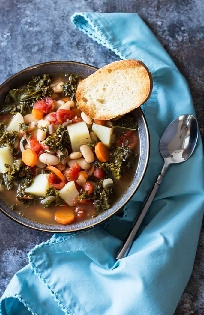 Kale Soup -- You'll never miss the meat in this hearty and comforting soup full of kale, beans and veggies!