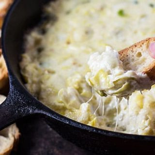 Cheesy Baked Artichoke Dip -- Creamy, cheesy and full of artichoke hearts. This easy recipe is great for a crowd   theblondcook.com