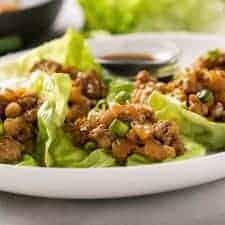 Chicken lettuce wraps on an oval white serving platter
