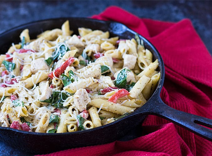 Chicken Pesto Pasta Bake - Creamy and cheesy pasta with chicken, spinach and roasted red peppers | theblondcook.com