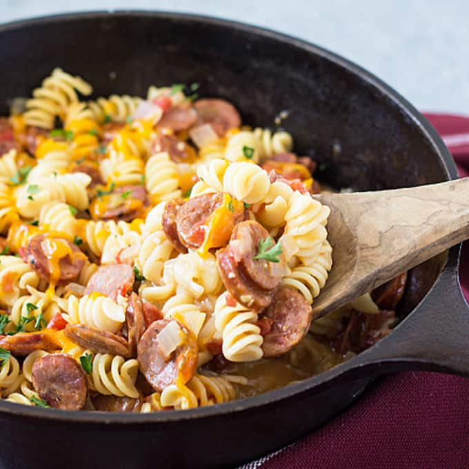 One Pan Cajun Andouille Sausage and Pasta - An easy weeknight meal that comes together in ONE PAN and under 30 minutes!
