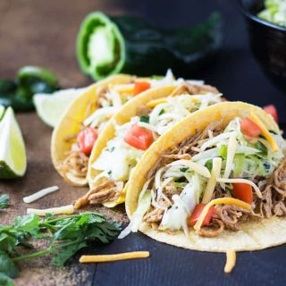 Chicken Tacos - Juicy and zesty shredded chicken with a cilantro lime poblano slaw   theblondcook.com