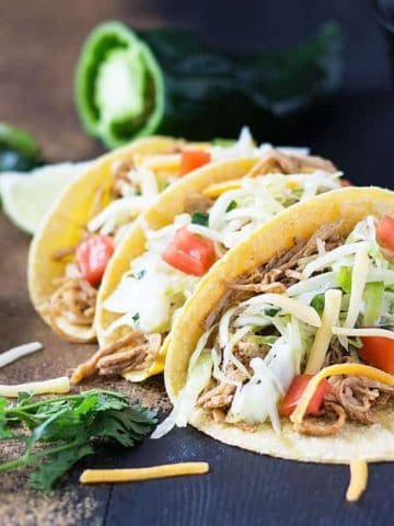 Chicken Tacos - Juicy and zesty shredded chicken with a cilantro lime poblano slaw | theblondcook.com
