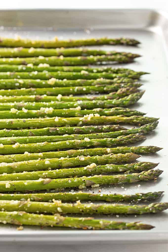 Roasted asparagus with garlic on a baking sheet
