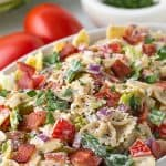 """A bowl of pasta salad with overlay text that reads """"BLT Pasta Salad""""."""