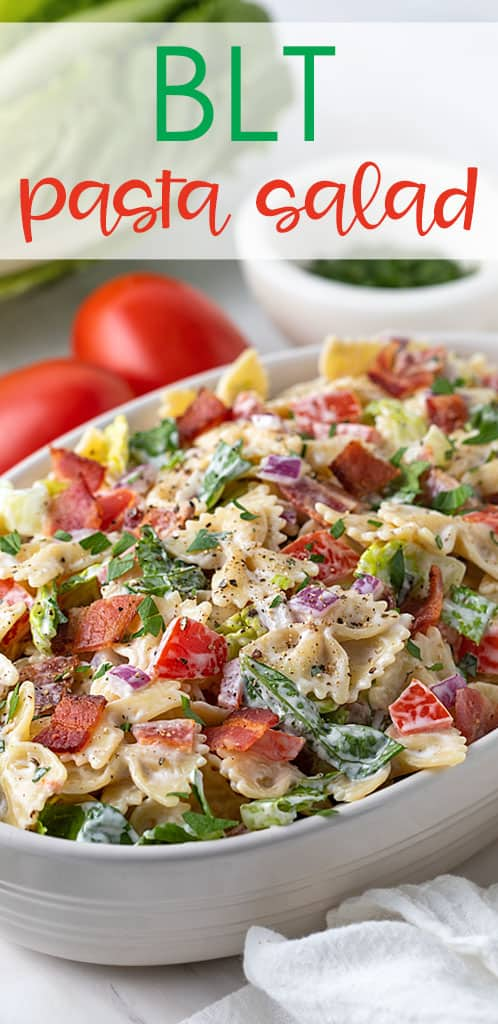 Closeup of BLT pasta salad in an oval white bowl.
