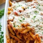 Chicken Parmesan Casserole in a baking dish with a spoonful of casserole removed