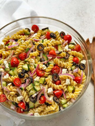 Overhead view of Easy Greek Pasta Salad in a large glass bowl
